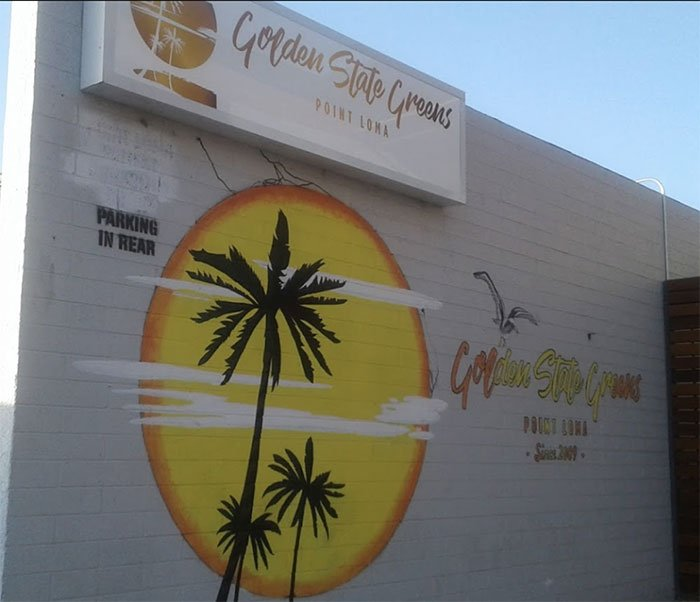 Golden State Greens mural on brick wall